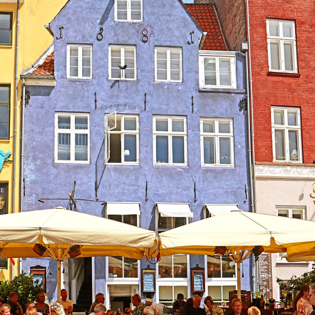 """""""COPENHAGEN, DENMARK - JUNE 16, 2019 People seat at one of the many..."""" stock image"""