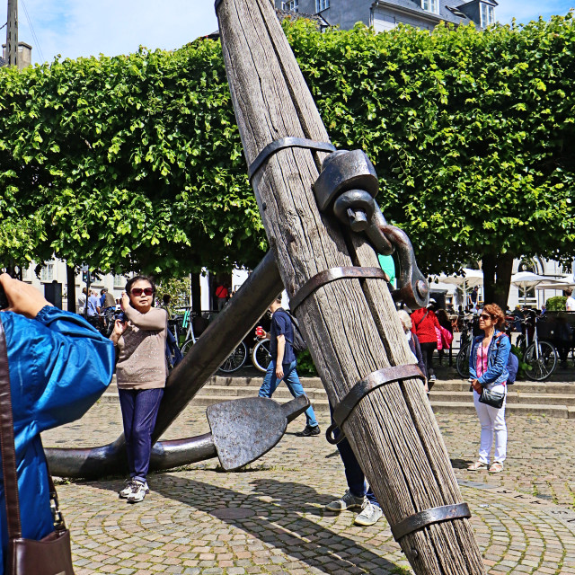 """""""COPENHAGEN, DENMARK - JUNE 16, 2019 Tourists take pictures of a giant anchor ..."""" stock image"""