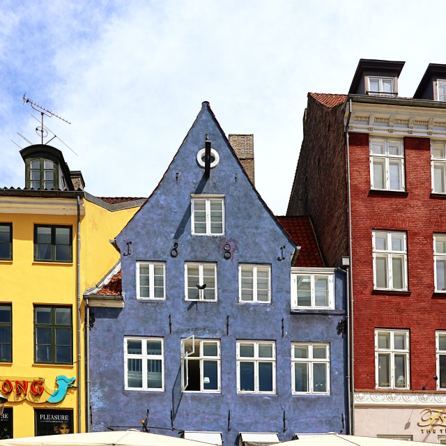 """COPENHAGEN, DENMARK - JUNE 16, 2019 Colorful houses parade at Nyhavn harbor..."" stock image"