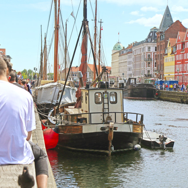 """COPENHAGEN, DENMARK - JUNE 16, 2019 Panoramic summer view of Nyhavn harbor..."" stock image"
