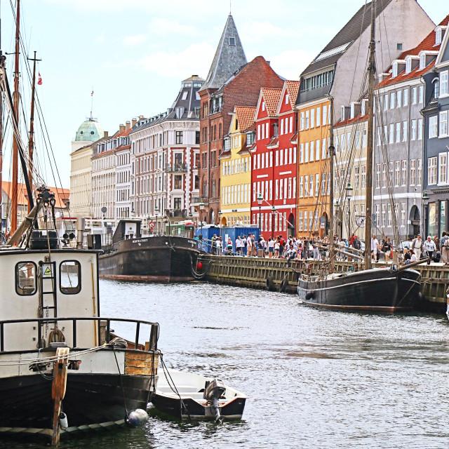 """COPENHAGEN, DENMARK - JUNE 16, 2019 Summer view of Nyhavn harbor, famous..."" stock image"