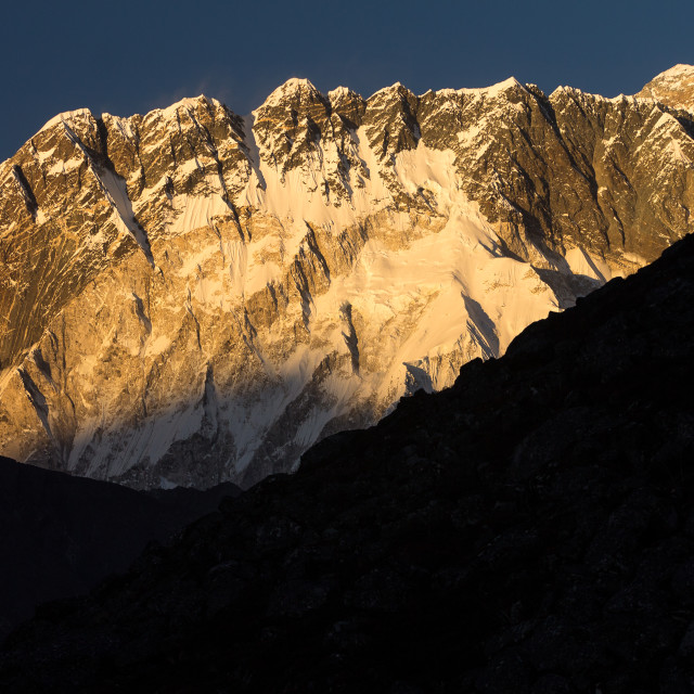 """Nuptse shortly before sunset with Everest rising above its long ridge"" stock image"