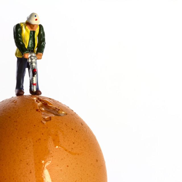 """Conceptual image of a miniature figure workman"" stock image"