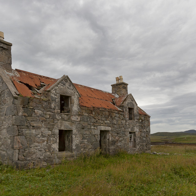 """""""A deserted, lonely house with a red roof"""" stock image"""