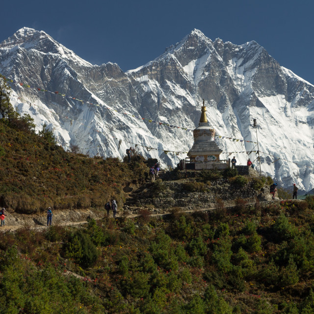 """""""Trekkers following the traverse above Namche Bazaar en route to Everest Base Camp"""" stock image"""