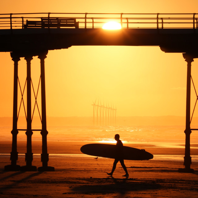 """Sunset and Surfer at Saltburn Beach"" stock image"
