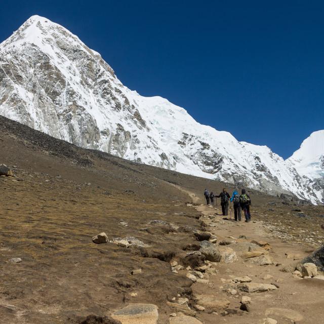 """Trekkers climbing Kala Patthar"" stock image"