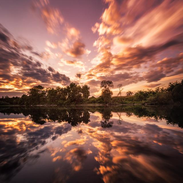"""Amazing sunset on the river"" stock image"