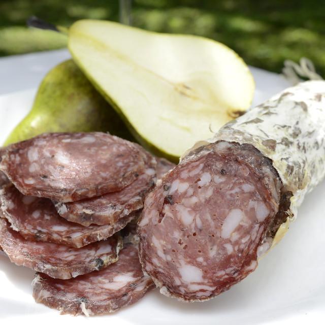 """A fall salami with dark grapes"" stock image"