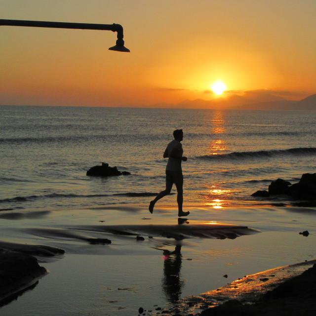 """Jogging At Sunrise"" stock image"