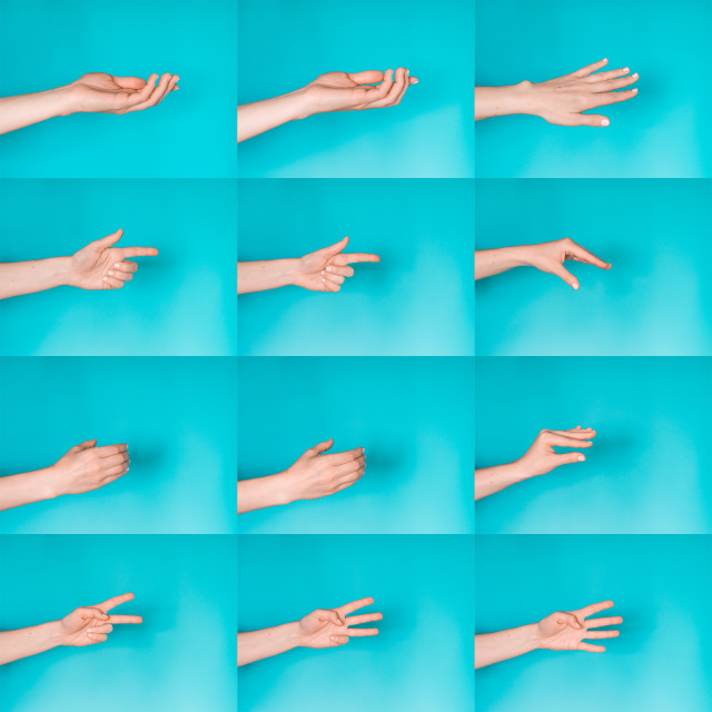 """Gesturing female hands on blue background"" stock image"