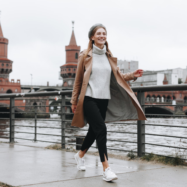 """""""Young woman walking by river in Berlin, Germany"""" stock image"""