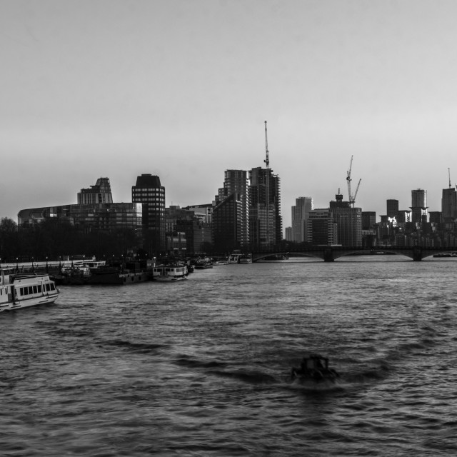 """Black and white cityskape of London at riverside"" stock image"