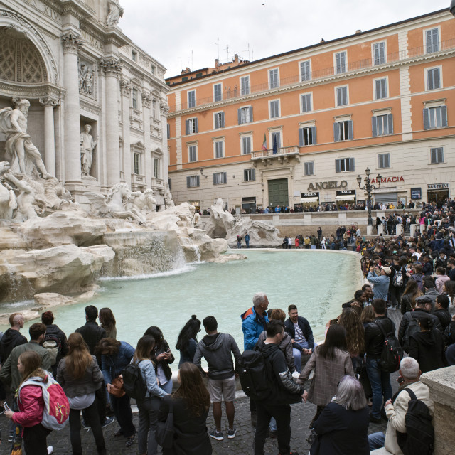 """Mass tourism - crowds at Trevi Fountain in Rome"" stock image"