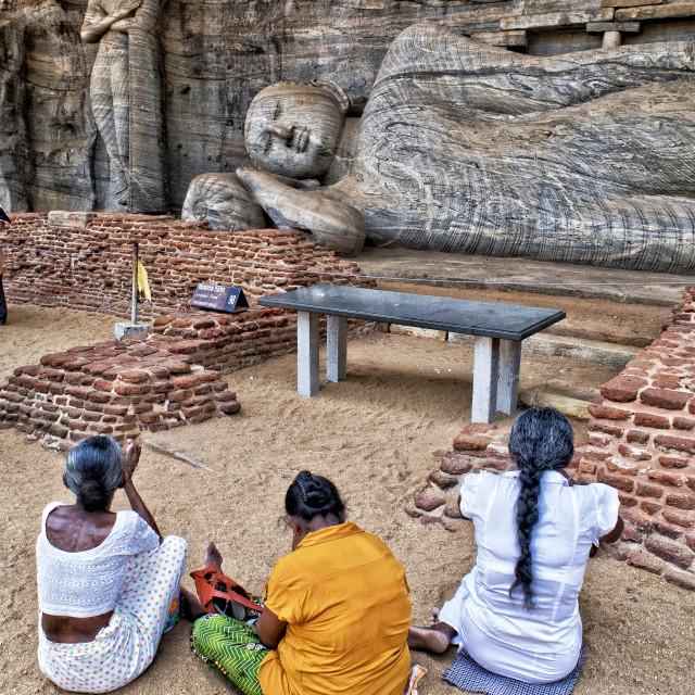 """Prayers by sleeping Buddha; Sri Lanka"" stock image"