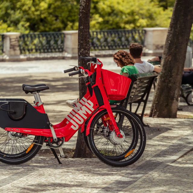 """Uber-Jump electric bicycle in a Lisbon park"" stock image"