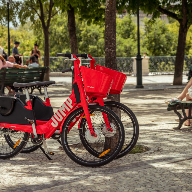 """Uber-Jump electric bicycle parked in a Lisbon park"" stock image"