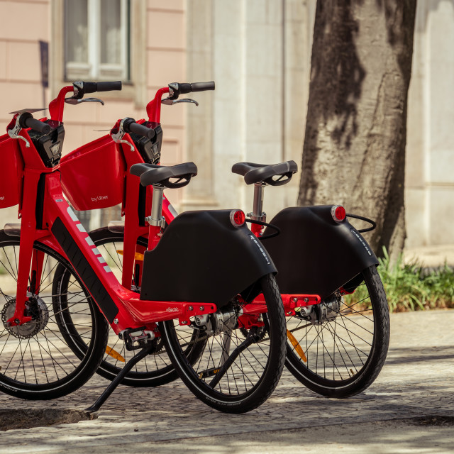 """Double red Uber-Jump electric bicycle Lisbon"" stock image"
