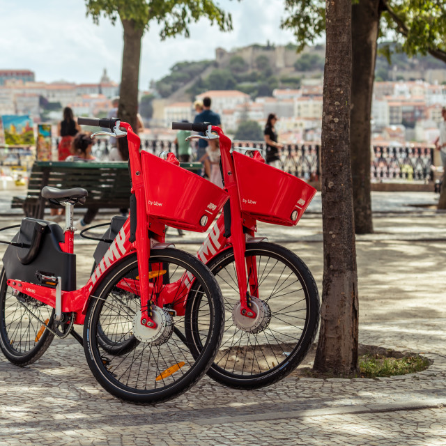 """Front view of two Uber-Jump electric bicycles"" stock image"