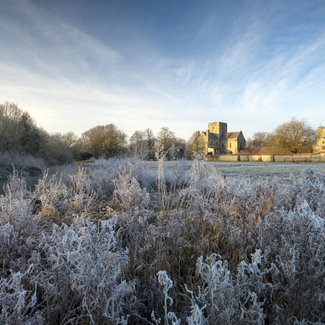 """Frosty winter sunrise with a hoarfrost view of St Cross Hospital, Winchester, Hampshire, UK"" stock image"