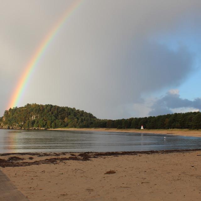 """Rainbow over Norwegian beach"" stock image"