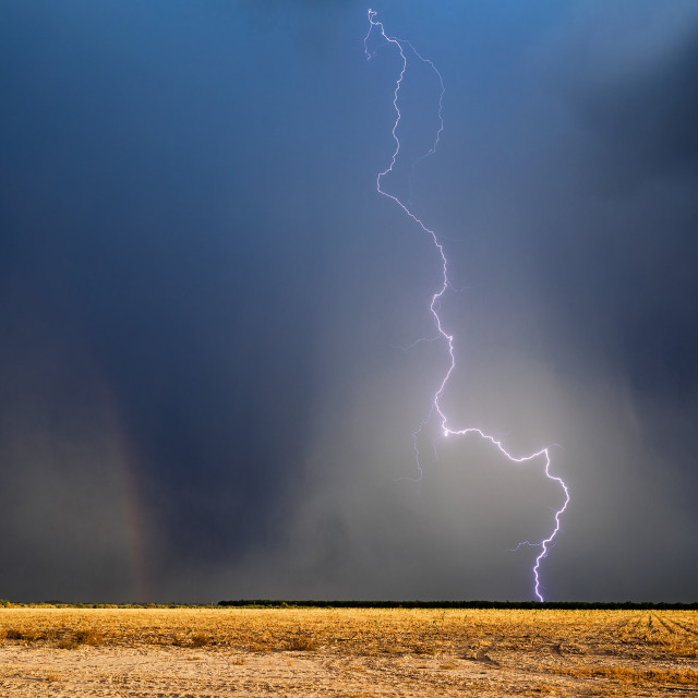 """Lightning strike and dark sky"" stock image"