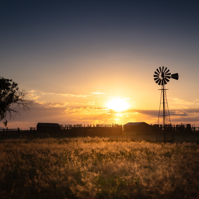 """Old Fashion Windmill at Sunset"" stock image"