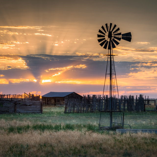 """Old Fashion Windmill at Sunset"" stock image"