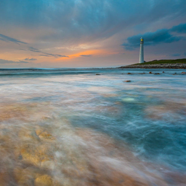 """Seascape and a lighthouse."" stock image"