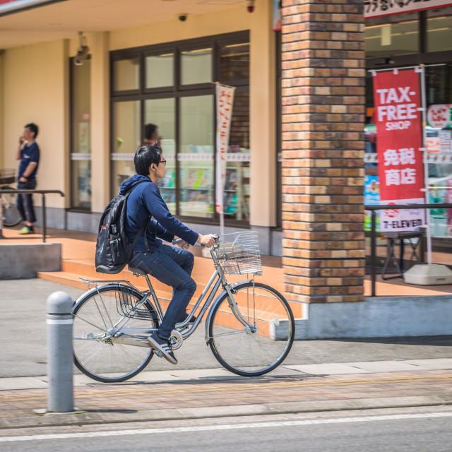 """Takayama - May 26, 2019: Locals riding a bike in Takayama, Japan"" stock image"