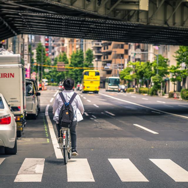 """Tokyo - May 19, 2019: Man riding a bike in Asakusa, Tokyo, Japan"" stock image"