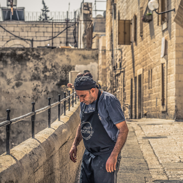 """""""Jerusalem - October 04, 2018: Merchant in the ancient corridors in the old..."""" stock image"""