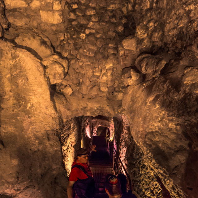"""""""Jerusalem - October 04, 2018: Travelers in the tunnels of the Ancient City of..."""" stock image"""
