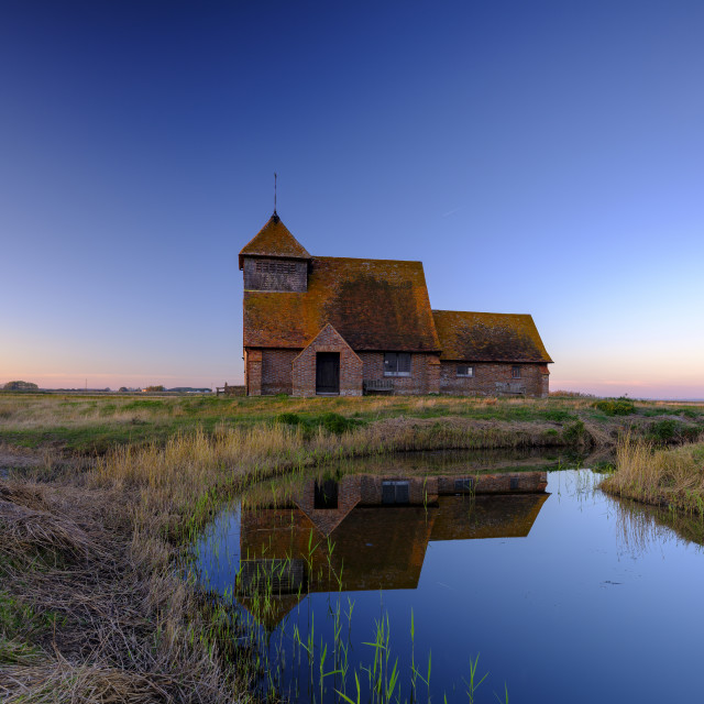 """""""Autumnal clearing evening sunset over St Thomas a Becket Church,"""" stock image"""