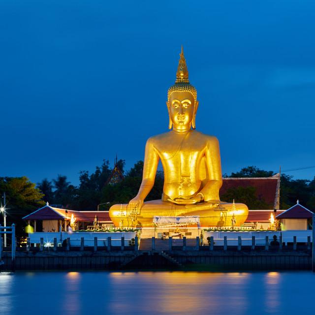 """A 19 metre (62ft) Buddha at Wat Bang Chak on the north bank of the Chao..."" stock image"