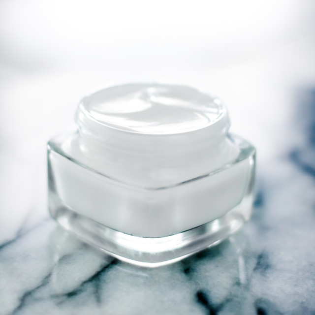 """Moisturizing beauty face cream on blue marble stone, skincare and spa cosmetics"" stock image"