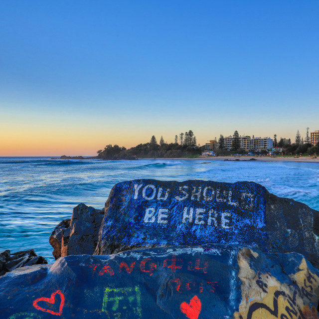 """Colorful rock graffiti ""You should be here"" NSW, Port Macquarie, Australia"" stock image"