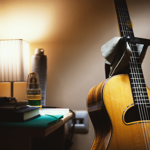 """Acoustic Guitar in Room"" stock image"
