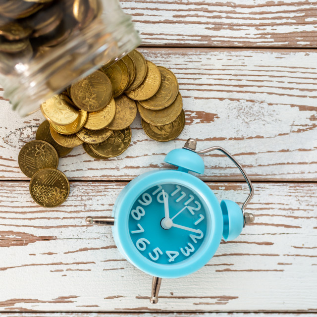 """""""Savings for the future. Malaysia coins and clock on wooden background...."""" stock image"""