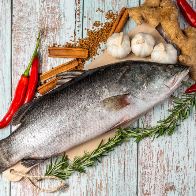 """""""Fresh Sea Bass on wooden table"""" stock image"""