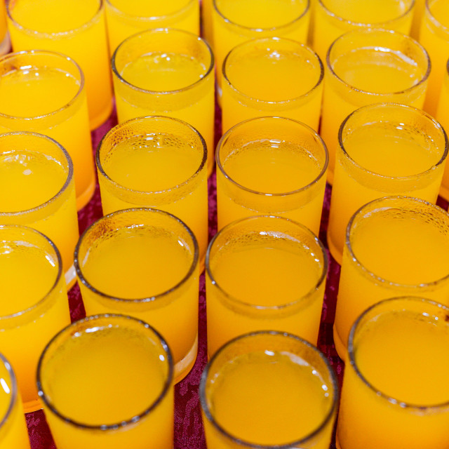 """Glasses of Orange Juice. Shallow depth of field."" stock image"