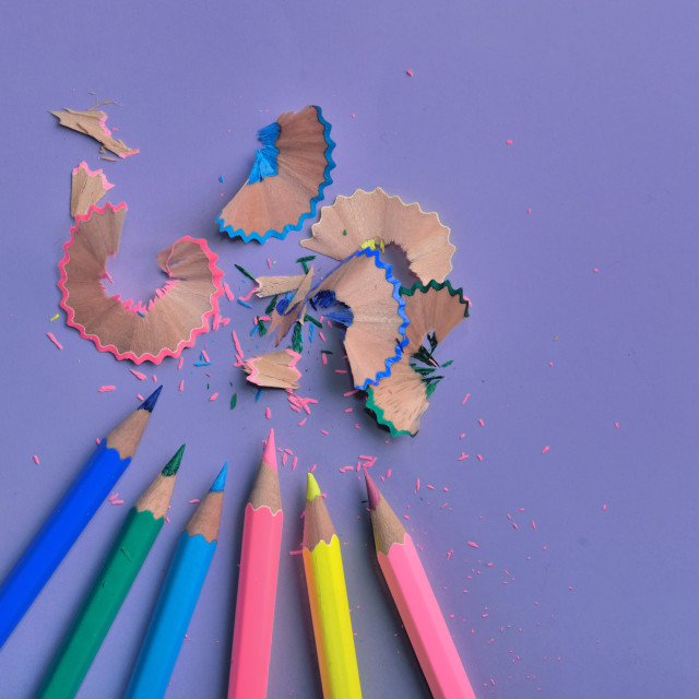 """""""close on wooden colorful pencils sharpened on colored paper background"""" stock image"""