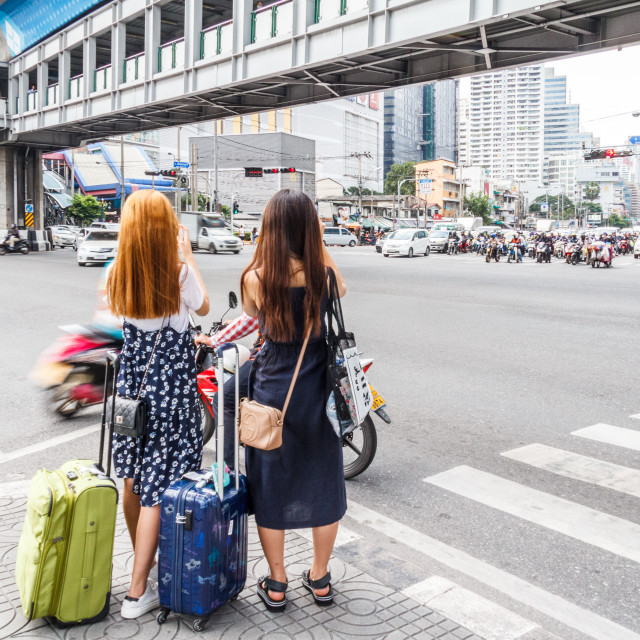 """""""Bangkok, Thailand - August 10th 2017: Two asian tourists with suitcases..."""" stock image"""
