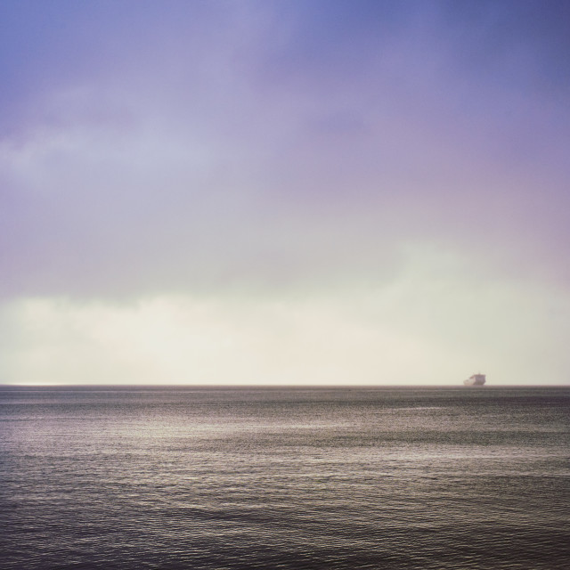"""""""The ferry crept out of the dawn mist to the the secret isle"""" stock image"""