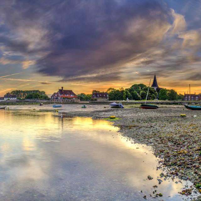 """Bosham, UK - June 2, 2019: Summer sunrise over the village of Bosham at low tide with the harbour and wadeway, West Sussex, UK"" stock image"
