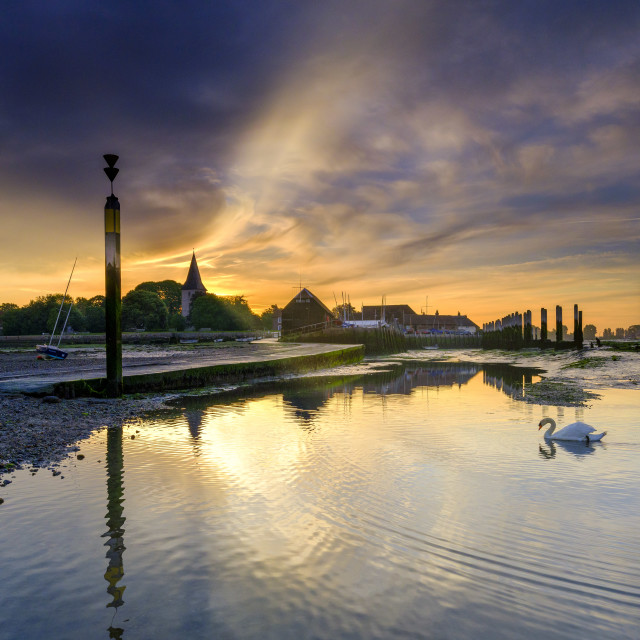 """Summer sunrise over the Holy Trinity Church and Bosham Quay in W"" stock image"
