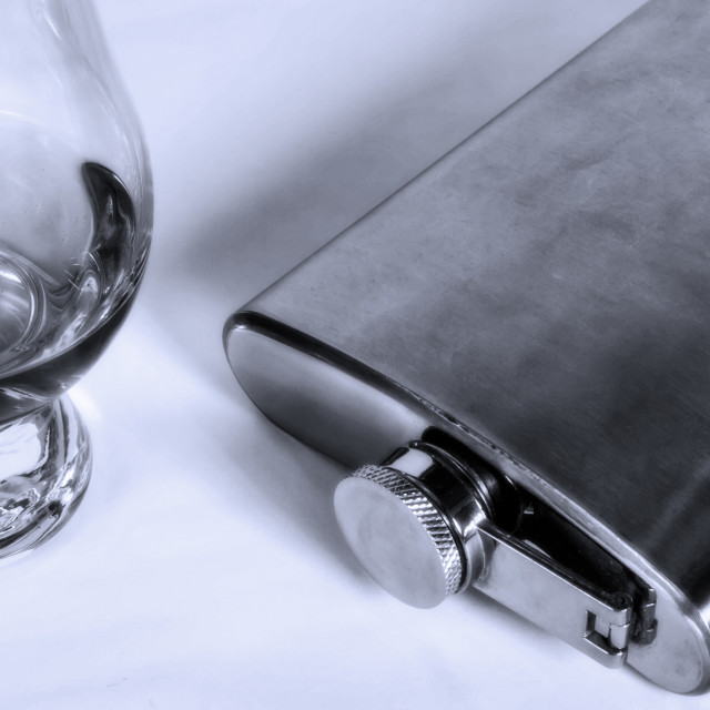 """""""Whiskey snifter glass & flask"""" stock image"""