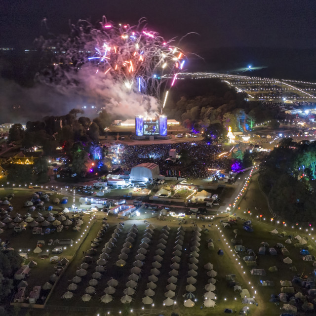 """""""A fireworks finale mark the end of Camp Bestival at Lulworth Castle in Dorset last night in this shot seen by drone. The Festival saw tens of thousands of people flock to the family orientated event with headliners Jess Glynne, Nile Rodgers and Annie Mac."""" stock image"""
