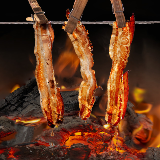 """""""food in motion - roasting with splashes and crashes"""" stock image"""