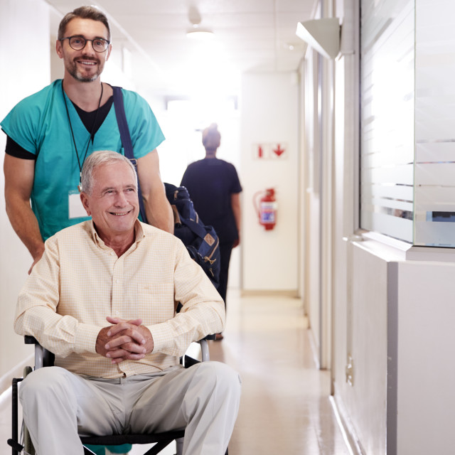 """""""Male Orderly Pushing Senior Male Patient Being Discharged From Hospital In..."""" stock image"""